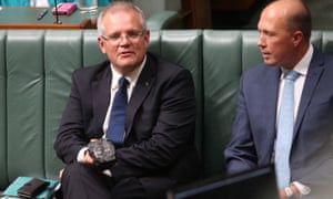 Photos of Scott Morrison with a lump of coal parliament have become an enduring symbol internationally of Australia's lack of action on climate change, says Adam Morton in this episode of Full Story.
