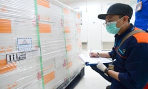 Workers register boxes containing coronavirus vaccines made by Chinese company Sinovac, after arriving at a facility of state-owned pharmaceutical company Bio Farma in Bandung, West Java, Indonesia, Monday, 7 December 7, 2020.