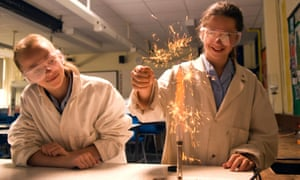 Secondary school pupils undertaking a science experiment in the laboratory.