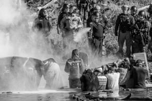 Police Mace water protectors and pipeline protesters at Cannon Ball, November 2016
