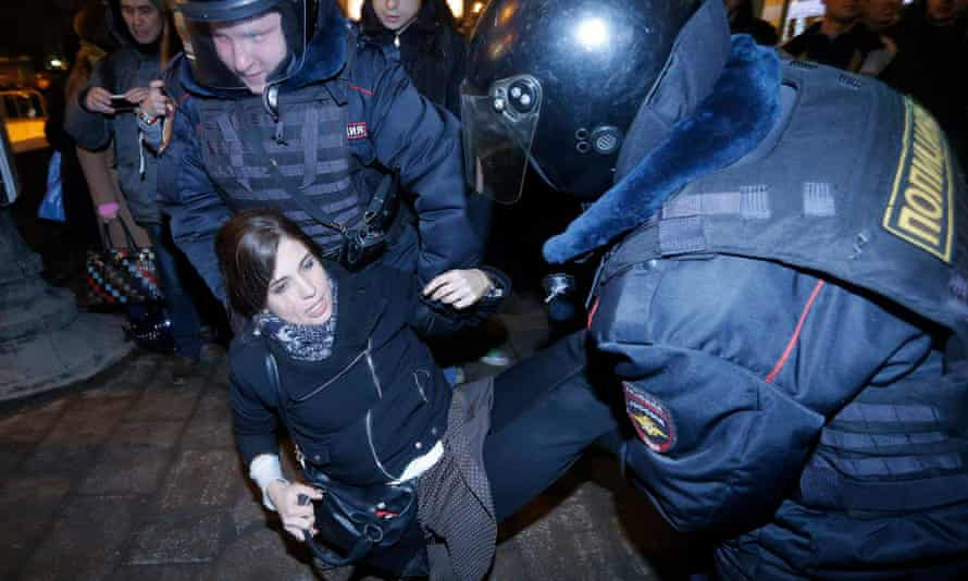 Pussy Riot member Nadezhda Tolokonnikova being detained by police at a protest in central Moscow in February 2014.