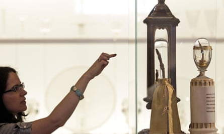 A woman looks at fingers of Galileo Galilei on display at the Galileo Museum of science, in Florence,