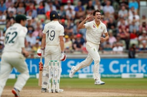 Pat Cummins celebrates Australia's victory after taking the wicket of Chris Woakes.