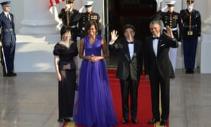 Barack Obama and Michelle Obama with Shinzo Abe and his wife, Akie Abe, as they arrive for a state dinner at the White House on Tuesday.