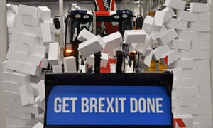 ' The election campaign had just hit a new low.' Johnson drives a JCB through a wall with the Conservative Party slogan 'Get Brexit Done' in the digger bucket.