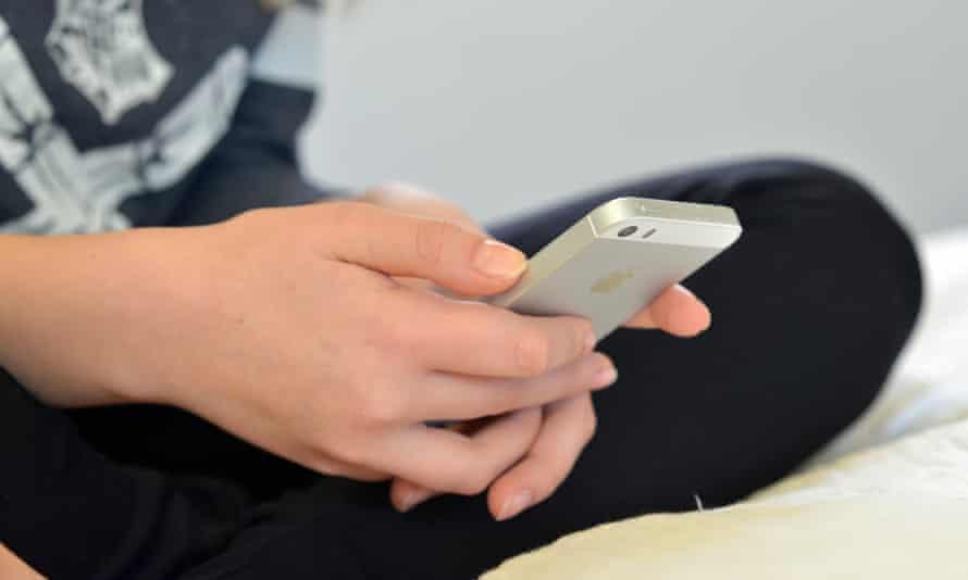 A teenage girl using a mobile phone