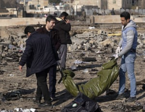 Iranian relative of a passenger mourns at the site of a crash of a Boeing 737 jet about 30 miles south of Tehran on January 8, 2020. All 176 passengers on board were killed during the Ukrainian plane crash shortly after take-off from the Imam Khomeini International airport.