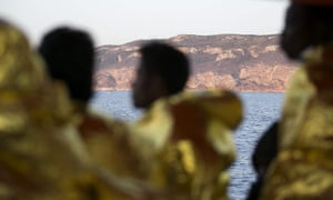 Rescued refugees and migrants arrive at Trapani harbour in Sicily