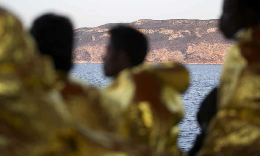 Rescued migrants arrive at Trapani harbour in Sicily
