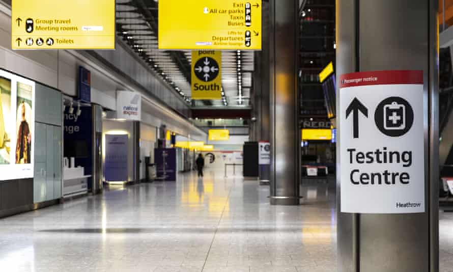 A sign for COVID-19 testing centre is seen at the Heathrow international arrival hall