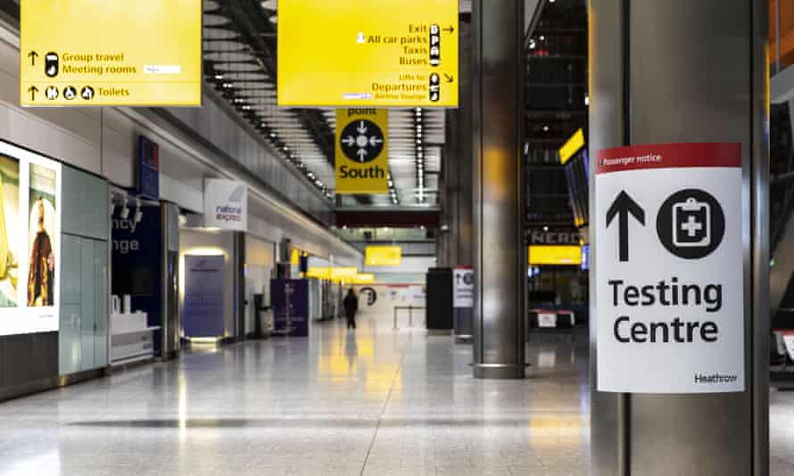 Sign for a Covid-19 testing centre at the Heathrow international arrivals hall this January