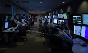 Analysts working in the top-secret SCIF room (Sensitive Compartmented Information Facility) at McConnell Air Force Base in Wichita.