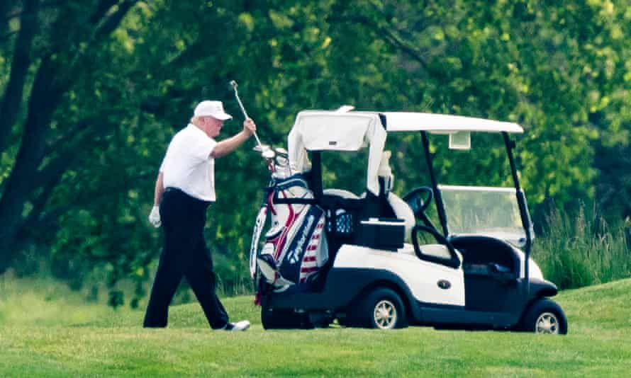 Donald Trump plays golf at the Trump National Golf Club in Sterling, Virginia.