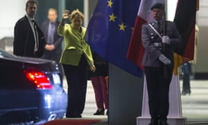 German Chancellor Angela Merkel waves to French President Francois Hollande after talks at the chancellery in Berlin.