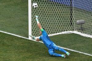 Essam El Hadary dives to save Fahad Al Mulwallad's penalty kick.