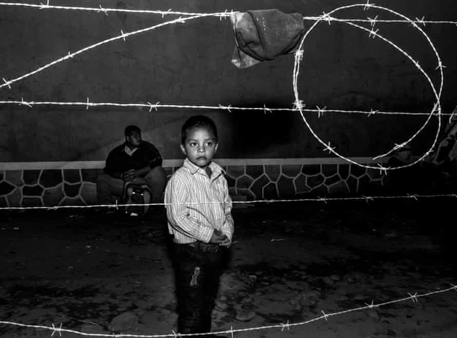 After sleeping in a wasteland by the Guatemala/Mexico border, José, a 6-year-old travelling with his father from Honduras, is waiting to start his journey once more via the Suchiate River at 3am