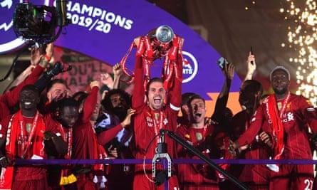 Jordan Henderson lifts the Premier League trophy in July.