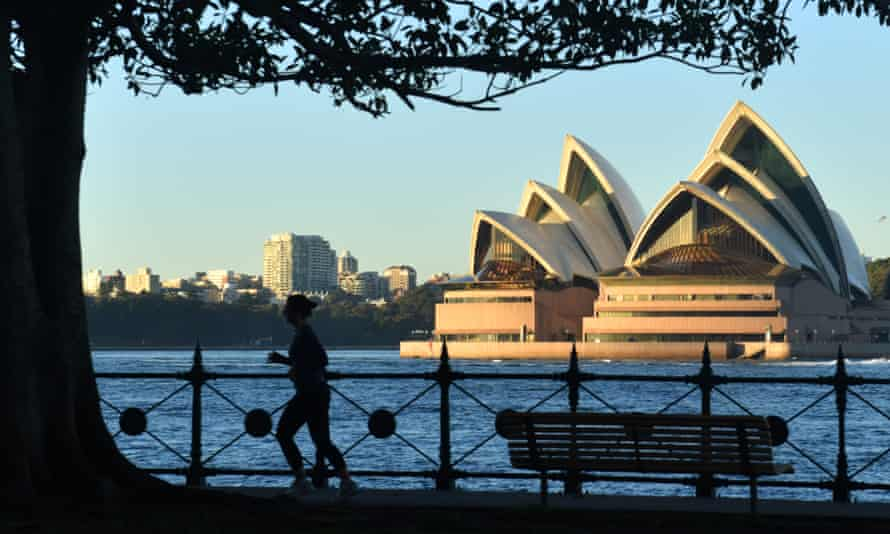 A lone jogger with the Opera House in the background