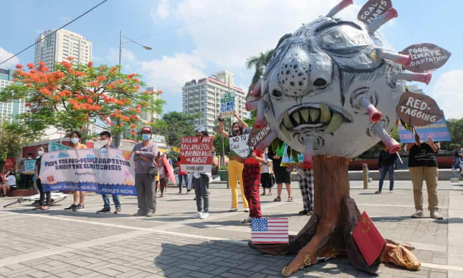 Protesters stand next to a two-metre effigy of president Rodgrigo Duterte in Manila, the Philippines, as part of the global climate strike on 24 September 2021