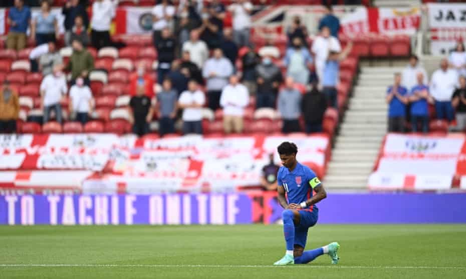 Marcus Rashford takes the knee amid angry boos before England's game with Romania.