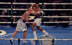 Oleksandr Usyk punches Anthony Joshua on his way to winning their World Heavyweight title boxing fight at the Tottenham Hotspur Stadium.