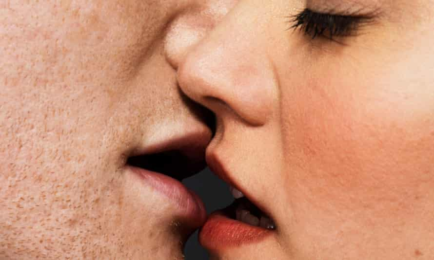 Man and woman about to kiss.