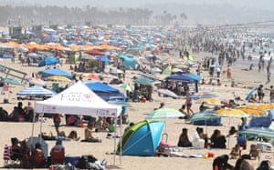 People gather on the beach at the Pacific Ocean on the first day of the Labor Day weekend amid a heatwave on 5 September 2020 in Santa Monica, California. Temperatures are soaring across California, sparking concerns that crowded beaches could allow for wider spread of the coronavirus.