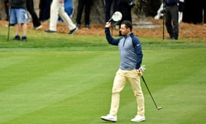 Rory McIlroy waves to the gallery on the 18th hole