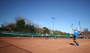 Members play tennis after the re-opening at West Bridgford Tennis Club, Nottingham