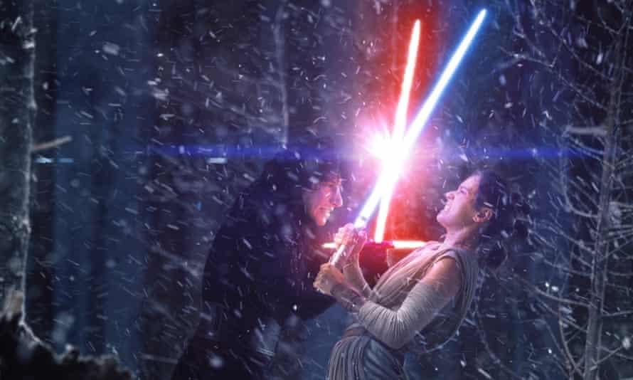 Kick ass … Kylo Ren (Adam Driver, left) battles with Rey (Daisy Ridley) in Star Wars: The Force Awakens.