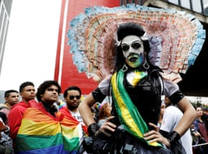 A striking costume and rainbow flags on the streets of São Paulo