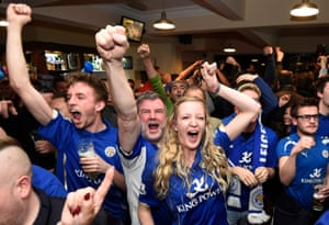 Supporters celebrate in the Market Tavern