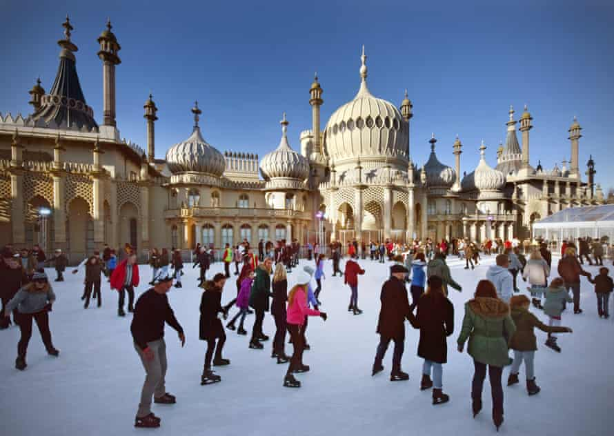 People ice skate at the open-air rink in front of the Royal Pavilion in Brighton during the period between Christmas and New Year