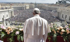 Pope Francis delivers the Urbi et Orbi blessing from St Peter's Basilica following the Easter Sunday mass.