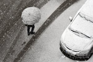 Bitlis, Turkey. A man walks with an umbrella during heavy snow in eastern Turkey