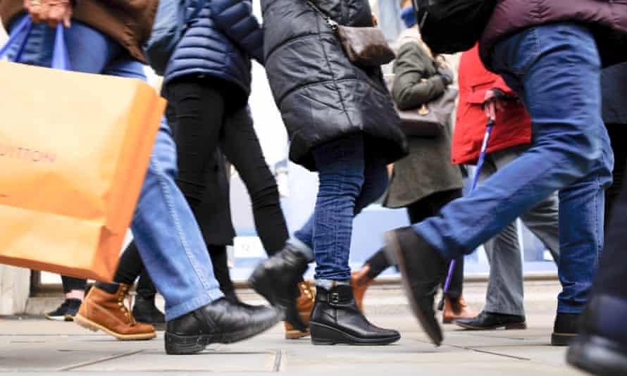 Shoppers seen walking along Regent Street