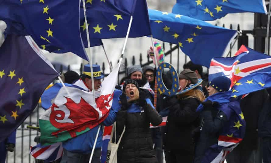 Anti-Brexit protestors wave flags outside Downing Street as European Council President Donald Tusk meets Britain's Prime Minister Theresa May in London.