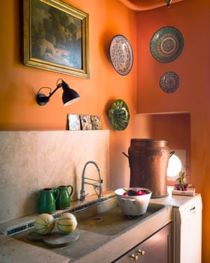 'I like to be cosy. Orange just worked': the kitchen, with traditional sink, and ceramics from Turkey and Morocco.