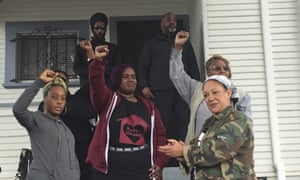Moms 4 Housing members, including Dominique Walker, left, outside the house in Magnolia Street in Okland which they will now able to buy.
