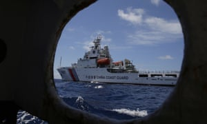 A Chinese Coast Guard ship attempts to block a Philippine government vessel as it tried to enter Second Thomas Shoal in the South China Sea in 2014.
