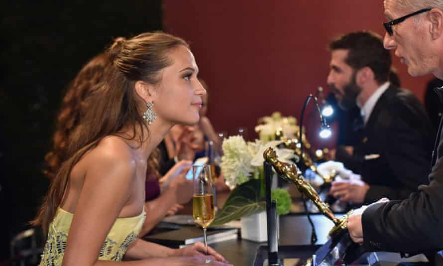 Alex Yust meets Alicia Vikander as he engraves her Oscar in February 2016.