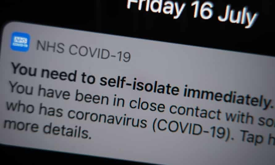 A notification issued by the NHS coronavirus contact tracing app - informing a person of the need to self-isolate immediately, due to having been in close contact with someone who has coronavirus - is displayed on a mobile phone.
