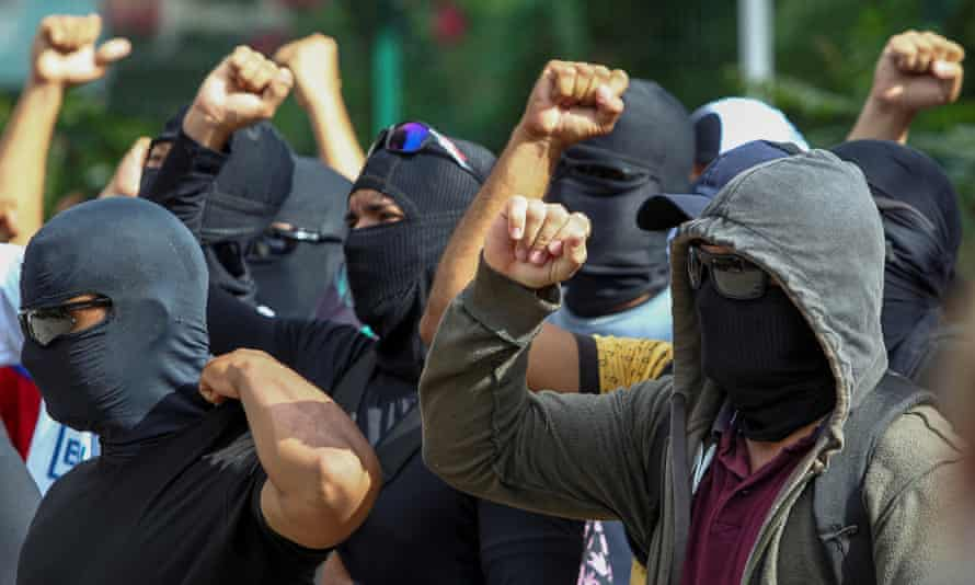 Hooded and masked police officers gather during a second day of police strike in Fortaleza, Ceará, in Brazil.