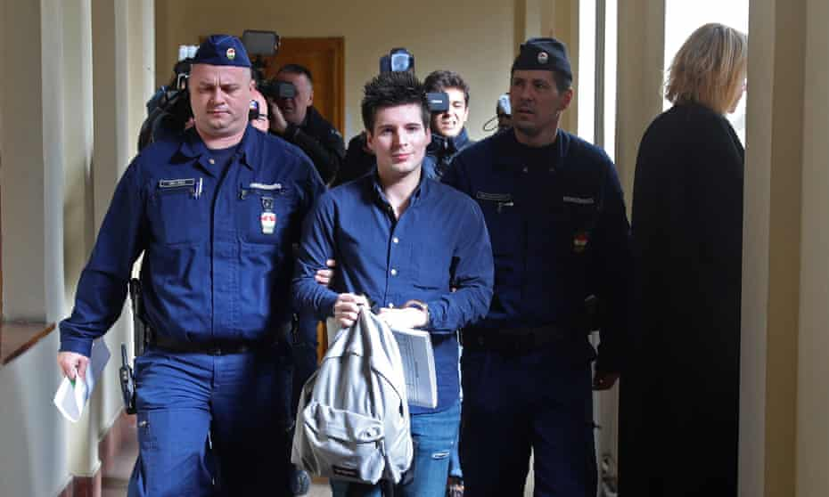 Rui Pinto is escorted by judicial officers as he arrives at the Metropolitan Court in Budapest, Hungary, in January 2020.