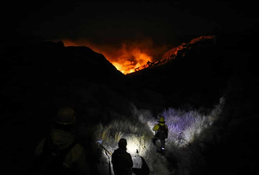 Firefighters attempt to get a blaze under control at the Parque Nacional Quebrada del Condorito