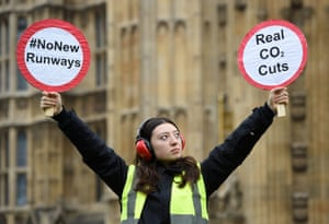 London, UKA protester from the Plane Stupid campaign demonstrates outside the Houses of Parliament before the government announcement on the expansion of Heathrow airport