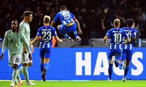 Vedad Ibisevic leaps over an advertising hoarding after scoring from the penalty spot to put Hertha Berlin ahead.