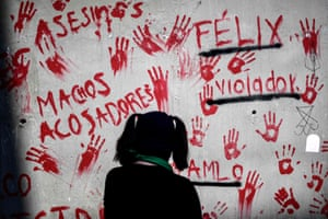 A woman at a protest calling for an end to violence against women, outside the investigation office of Cuauhtémoc mayor's office in Mexico City, on 2 March. Amnesty International said in a report the following day that authorities in five Mexican states, including the capital, violated the rights of women on such demonstrations in 2020, citing arbitrary arrests, physical and verbal aggression, threats and sexual assault.