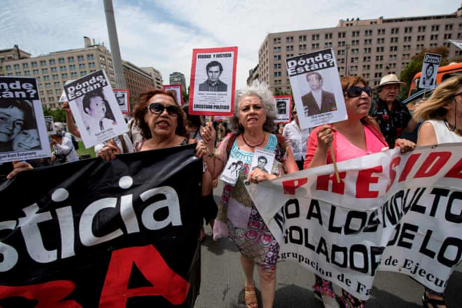 Relatives of people who disappeared during the military dictatorship demand the government of President Sebastian Pinera speeds up the search for victims, during a demonstration in front of La Moneda Presidential Palace in Santiago