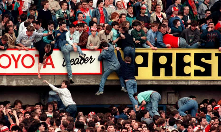 Liverpool supporters try to escape the crush on 15 April 1989.